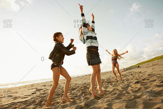 Girls playing on beach - Offset