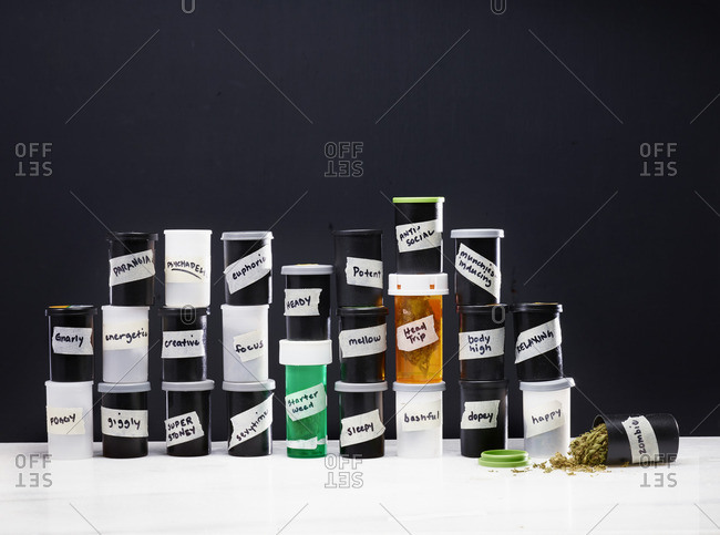 Canisters of various types of marijuana