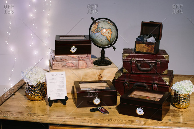 Close-up of table arranged with boxes of cigars for wedding reception