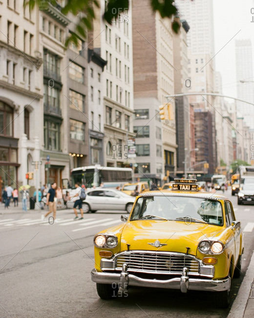 Vintage yellow taxi on the streets of the Bowery, NYC