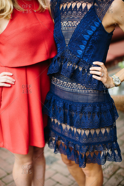 Two fashionable women in red and blue dresses