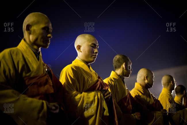 Nanjing, China - December 12, 2012: Monks attend a candlelight ceremony, held on the eve of the 75th anniversary of the Nanjing Massacre