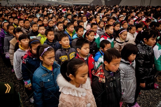 Nanjing, China - December 13, 2012: Chinese children lined up at the Nanjing Massacre Memorial Hall to commemorate the 75th anniversary of the Nanjing Massacre