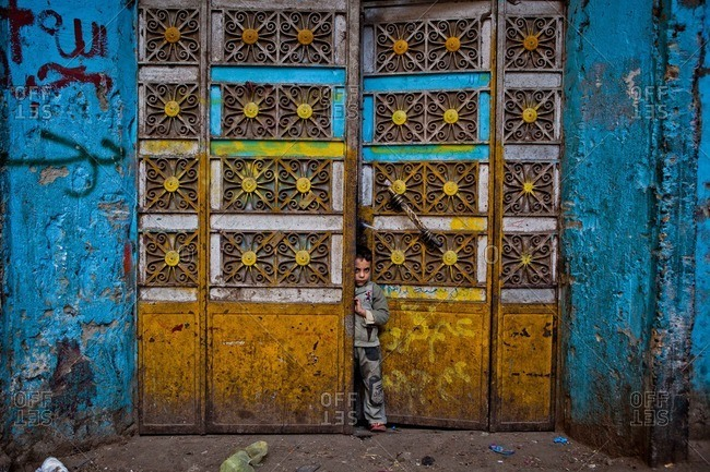Cairo, Egypt - January 15, 2012: A child peers out of his home in Manshiyat Naser, Cairo