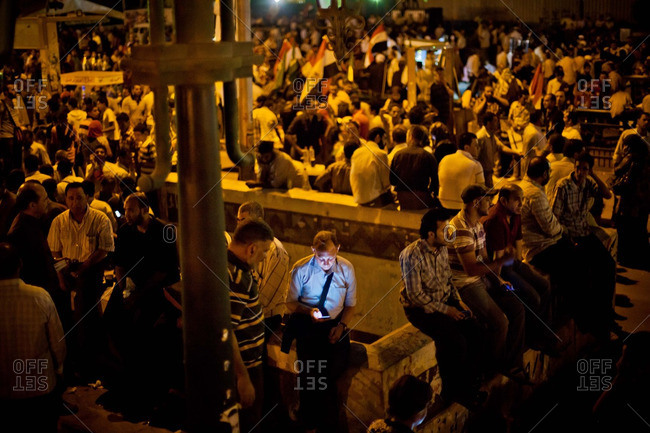 Cairo, Egypt - June 5, 2012: A man on his cell phone during a gathering in Tahrir Square
