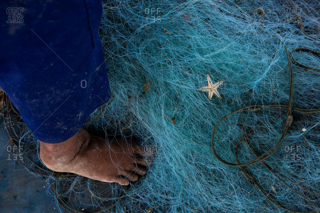 A Thai fisherman and his net