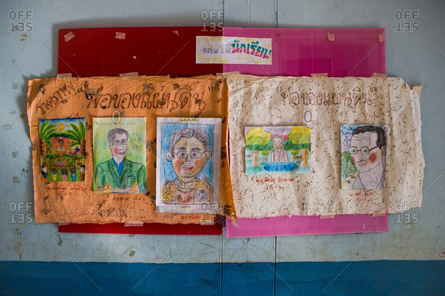 Thailand - January 27 2015: Drawings of Thailand's king hang in a primary school in northern Thailand