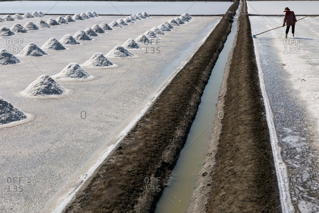 A salt field being harvested in Thailand