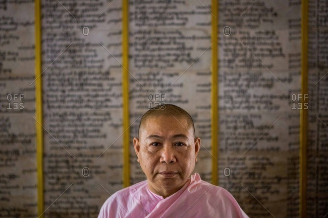 Yangon, Myanmar - April 15, 2015: A Buddhist nun poses for a portrait in a monastery in Yangon, Myanmar