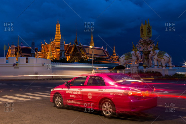 Bangkok, Thailand - July 14, 2016: A pink taxi passing by the Grand Palace in Bangkok, Thailand