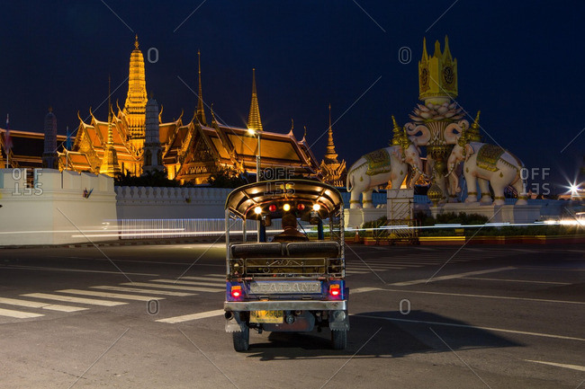 Bangkok, Thailand - July 14, 2016: A tuk-tuk driving towards the Grand Palace in Bangkok, Thailand