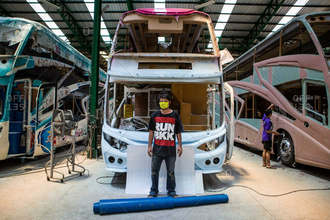 Muang, Thailand - July 15, 2015: A worker poses for a portrait in a bus factory in Aumphur Muang, Thailand