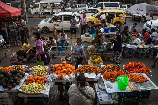 Yangon, Myanmar - January 6, 2015: Busy street scene in downtown Yangon, Myanmar