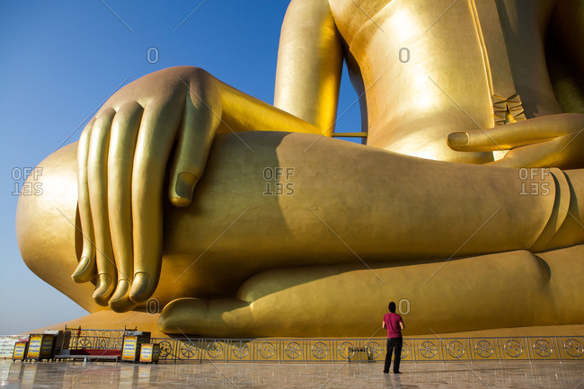 Ang Thong, Thailand - January 14, 2015: Tourist viewing the Great Buddha statue in Ang Thong, Thailand