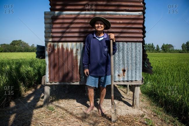 Ang Thong, Thailand - January 14, 2015: A Thai farmer in his field in Ang Thong, Thailand