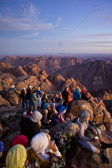 Egypt - October 8, 2011: Tourists watch the sunrise on top of Mount Catherine in the Sinai Mountains of Egypt