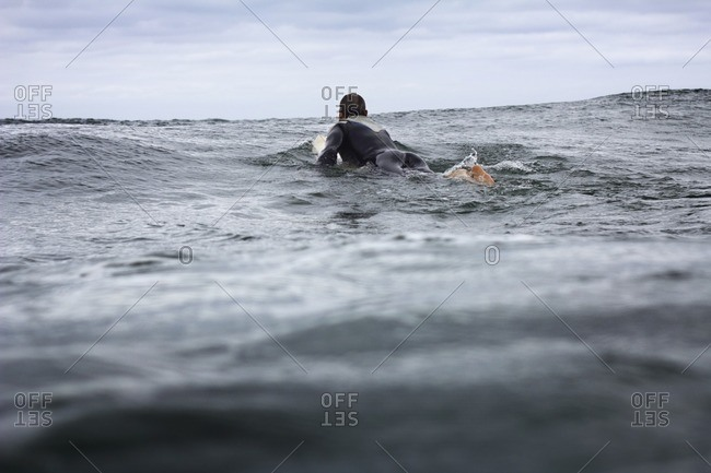 Man surfing in sea against sky