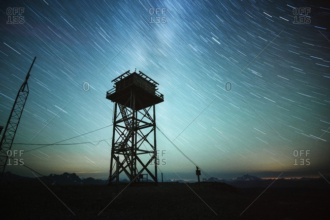 Low angle view of silhouette lookout tower against sky at night
