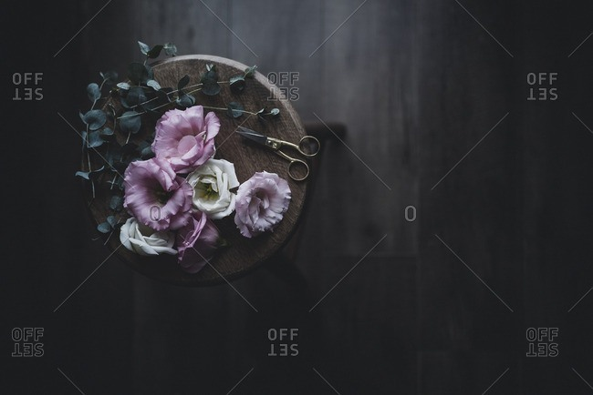 Overhead view of flowers on wooden stool