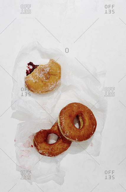 Overhead view of donuts on wax paper