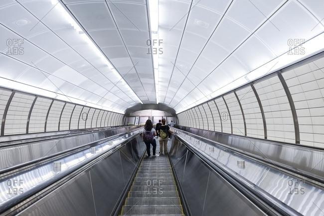 People riding the escalator