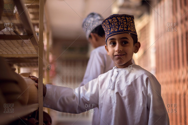 NIZWA, OMAN - APRIL 24 2015:Omani boy at the traditional market or souq in Nizwa, Oman.