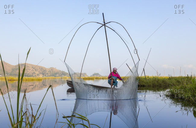 12/9/12: Fisherman removing net from water in rural India