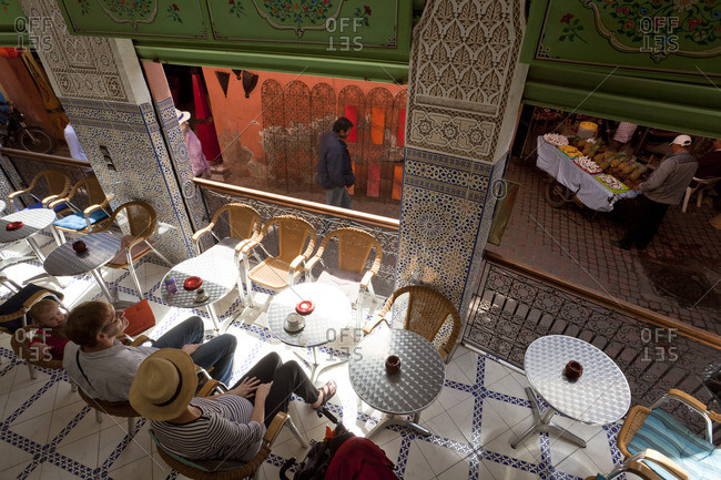3/23/11: Elevated view of tourists in a cafe in Marrakech, Morocco