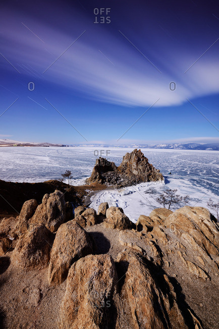 Distant view of Shamanka Rock on Burkhan Cape, Baikal Lake, Olkhon Island, Siberia, Russia