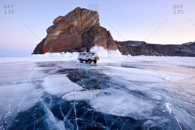 Siberia, Russia - March 6, 2015: Off road tourist vehicle at Khoboy Cape, Baikal Lake, Olkhon Island