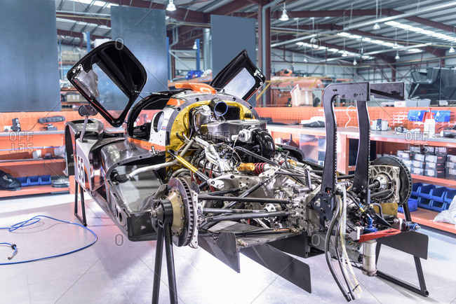 Car under construction and repair in racing car factory