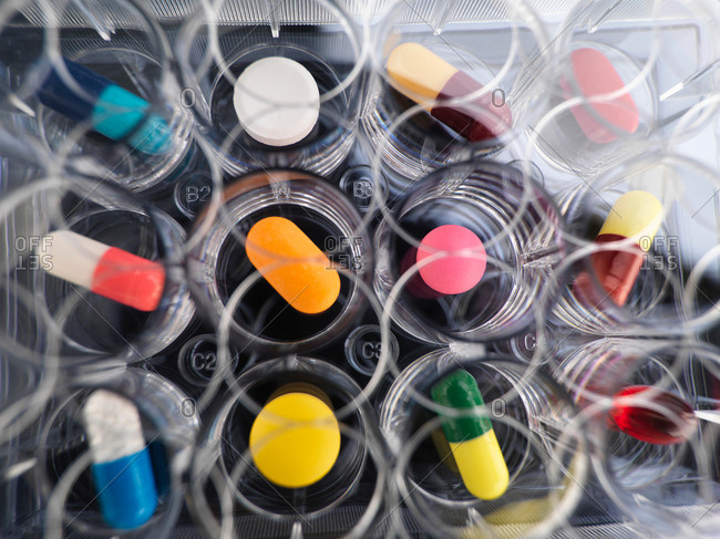 Pharmaceutical research, overhead view of  variety of medical drugs in a multi well tray for laboratory testing