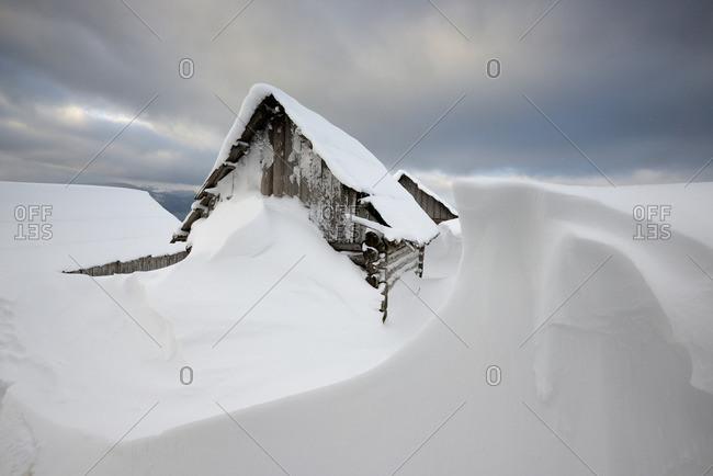 Shack covered in snow in a Chorna Tysa Mountain Village, Carpathian Mountains, Ivano-Frankovsk Region, Ukraine