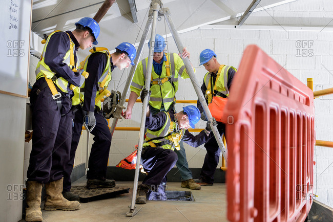 Apprentice builders learning how to use hoist in training facility