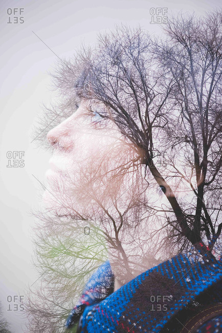 Young woman, side view and trees