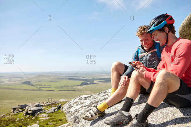Cyclists resting on rocky outcrop
