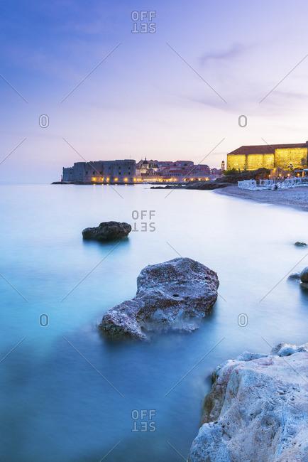 Sunset over Banyan beach and Dubrovnik old town, Dalmatia, Dubrovnik, Croatia