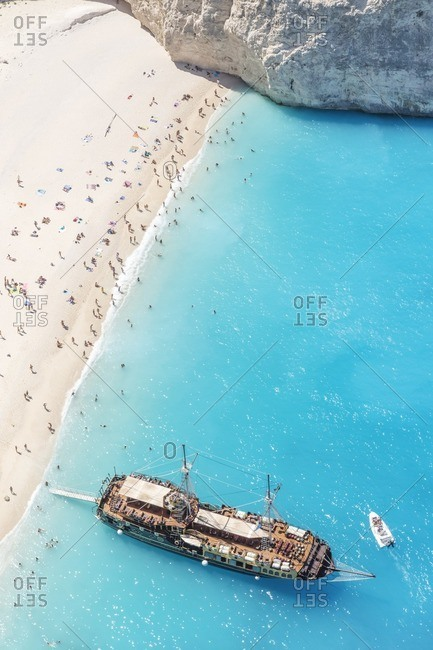 Zakynthos, Greek Islands, Greece - August 31, 2015: Aerial view of beach in summer with people and cruise ship