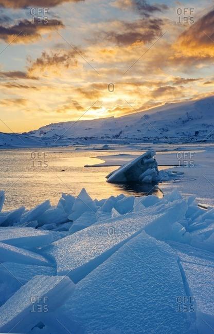 Blocks of ice in the frozen lagoon at sunset, Jokulsarlon glacier Lagoon, Iceland