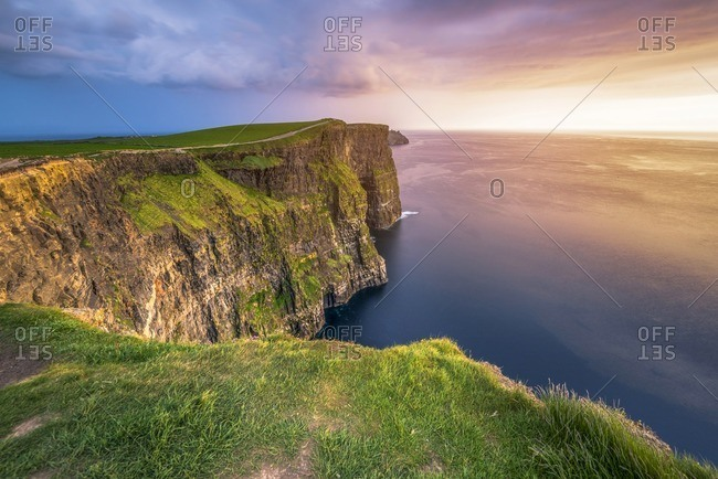 Sunset over the cliffs of Moher in Doolin, County Clare, Ireland