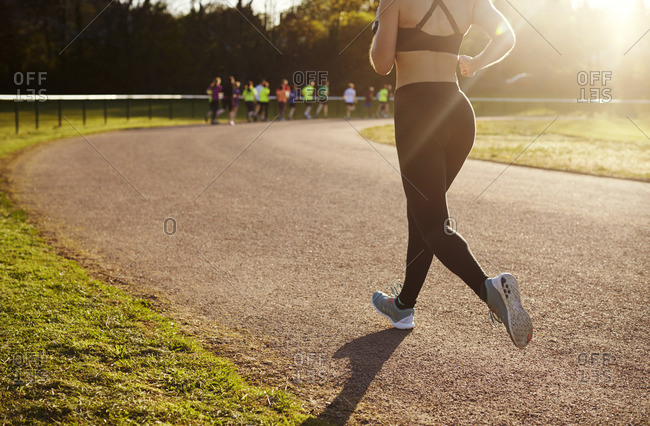 Close Up Of Woman Exercising On Outdoor Running Track