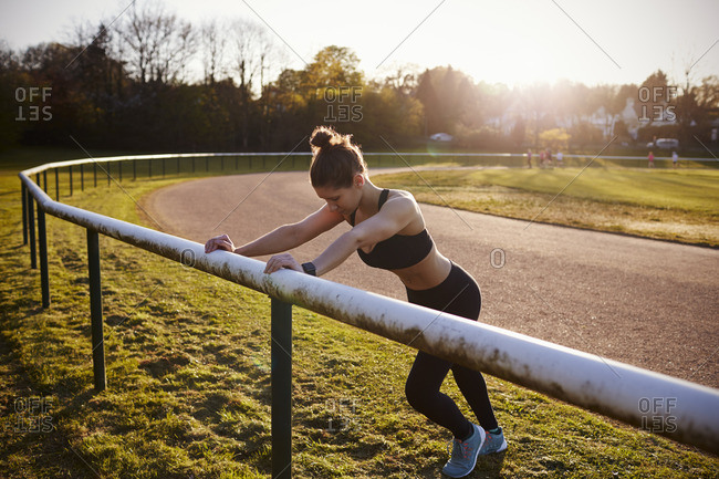 Young Woman Stretching During Outdoor Exercise