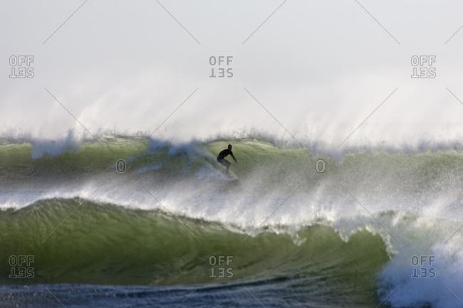 Man surfing on the wave in sea, Samara, Costa Rica