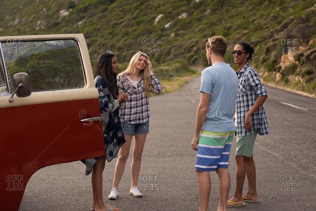 Young friends on road trip break