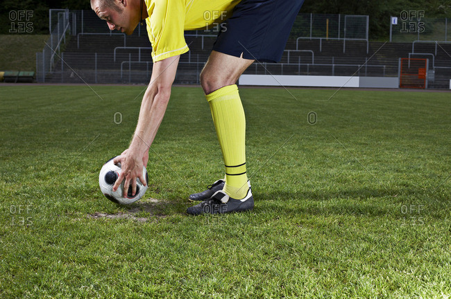 Soccer player placing ball on penalty spot