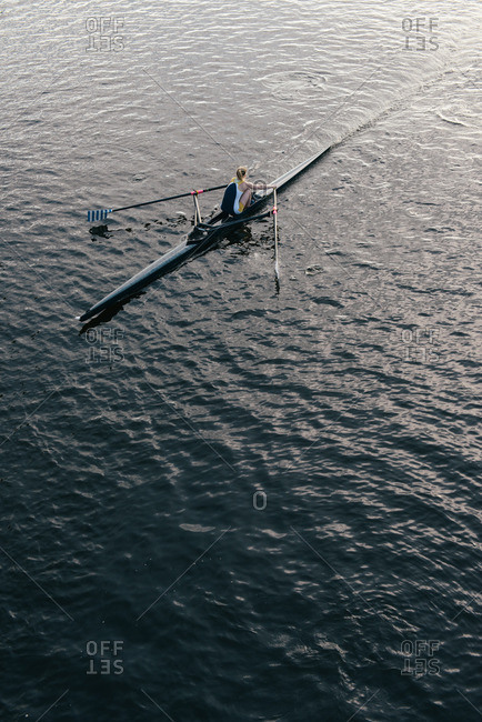 Woman sculling in river