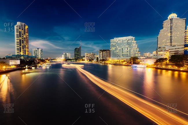 Thailand- Bangkok- view of skyline and Chao Praya River at twilight