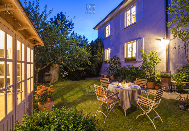 Laid table in garden in the evening
