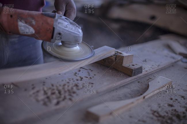 Cooperage- copper working with wood grinder