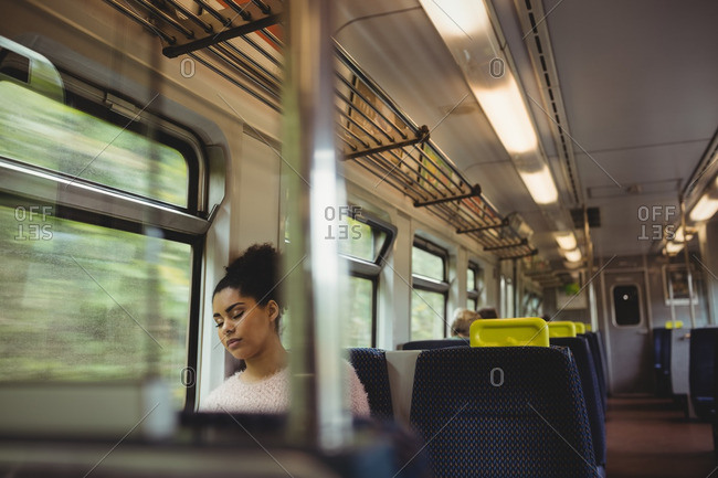 Beautiful woman napping in train